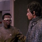 Geordi and Bochra smile at each other on the bridge after being rescued