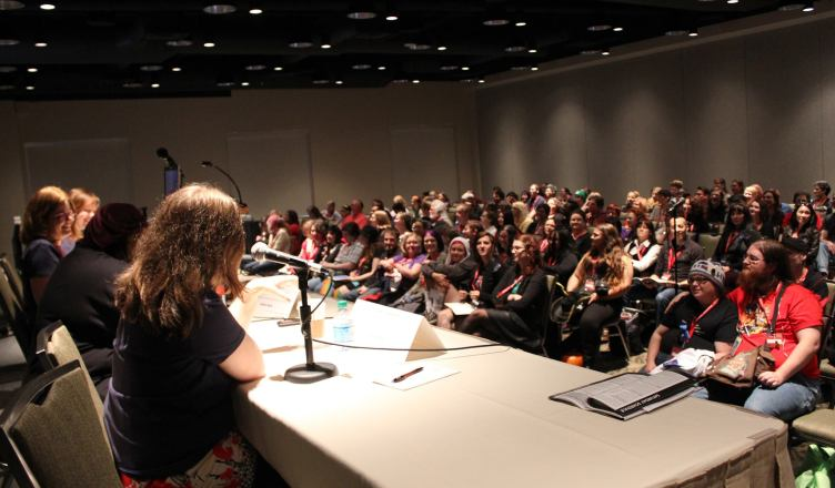 Audience at a convention panel.