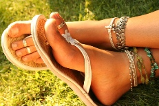 Woman's feet decorated with anklets, tow-rings and pretty sandels