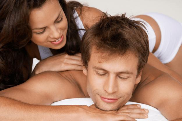 woman massages man with diy massage oil