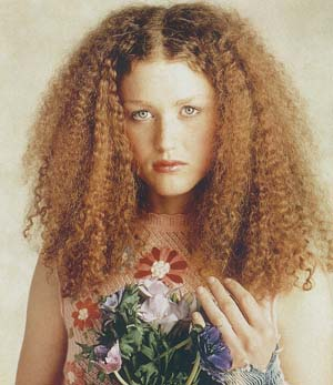 Medium Hair Style With Mini Curls Redish Brown