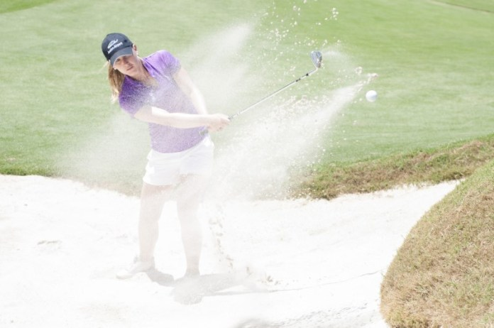 Sally Watson blasting out of a Royal Pines bunker