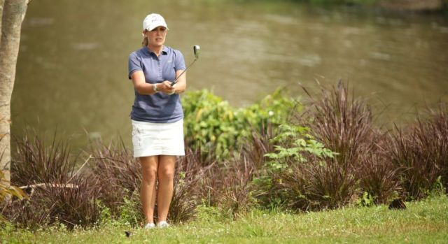 Cristie Kerr Womens Golf playing out of the rough