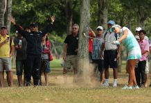 Lexi Thompson playing out of the rough womens golf