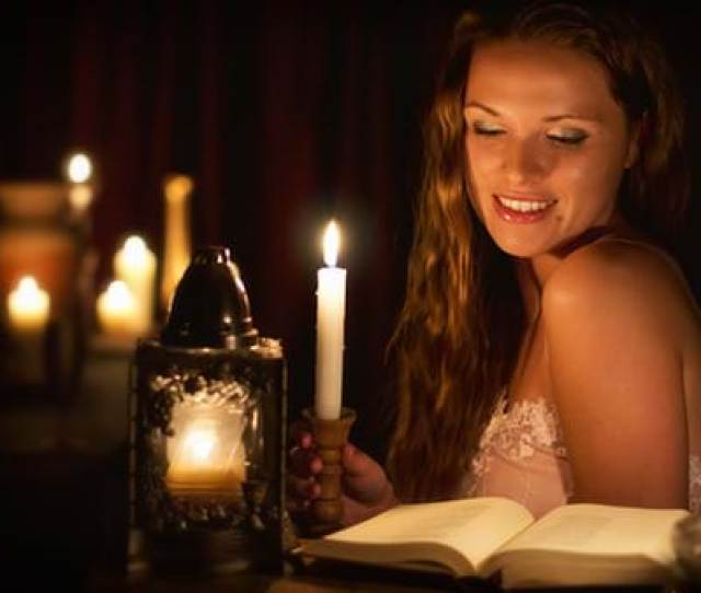 Beautiful Woman Reading An Erotic Book By Candlelight Masturbation