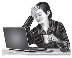 Woman with headache at computer
