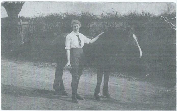 Land girl Dorothy Brown, The Grange, Gunthorpe, Peterborough c1916 grooming horse