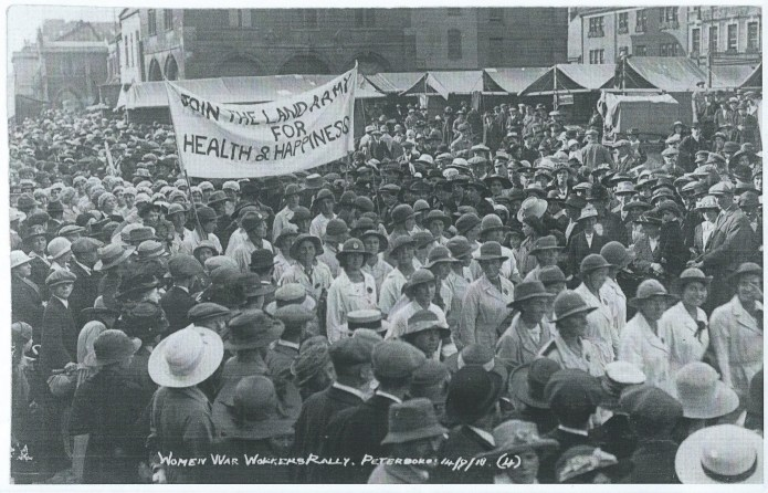 Land girls march with banner Join The Land Army For Health & Happiness, Peterborough 14 Sept 1918