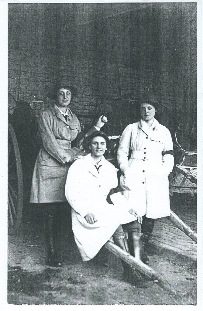 Three land girls in uniform at The Grange, Gunthorpe, Peterborough c1917