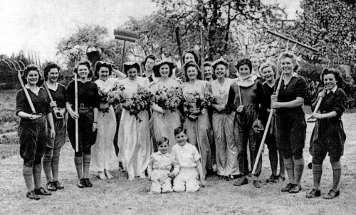 Peggy and her guard of honour. It shows the trouble that the land girls at that small hostel went to at that first event in 1944 to put on a really good show and involve a lot of people.
