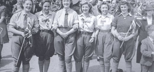 A group of Bedfordshire land girls who joined the crowds celebrating the VE Day radio announcement at 3pm in St Paul's Square, Bedford, 8 May 1945. 'Victory in Europe [VE] Day' marked the end of the Second World War in Europe. The Allies continued fighting in Japan in the Far East until VJ Day [Victory over Japan] on 15 August 1945. Source: Bedfordshire Times. Courtesy of Stuart