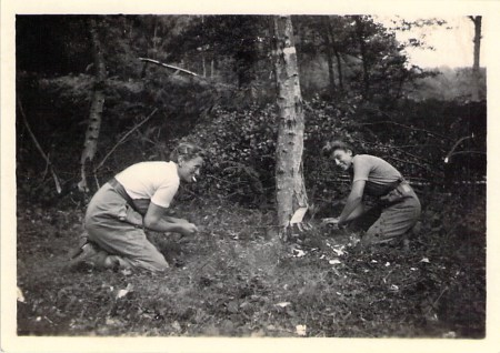 Using the cross-cut saw. Spenny and another woman.