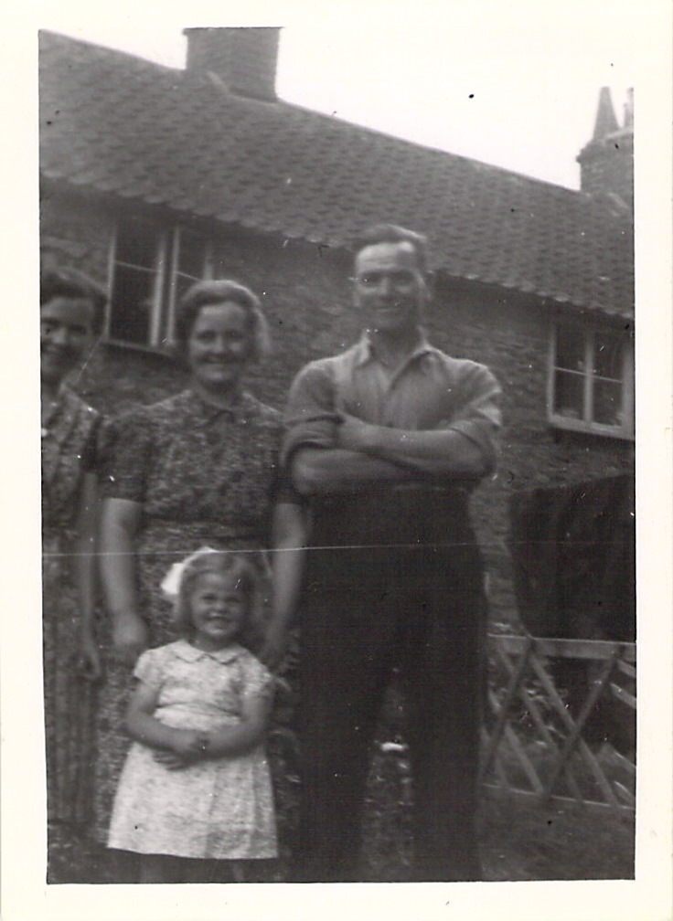 """Mrs Ashton, Mrs Cullimore, Mr Cullimore, and June outside """"The Ark"""" at Wootton-u-Edge, 1943."""