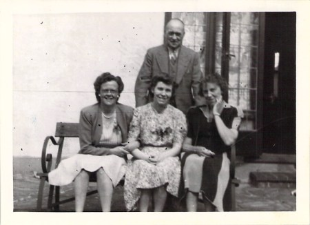 """Joy's father, Hilda, Marjorie, and Joy's mother outside """"The Homestead"""", London, 1943."""