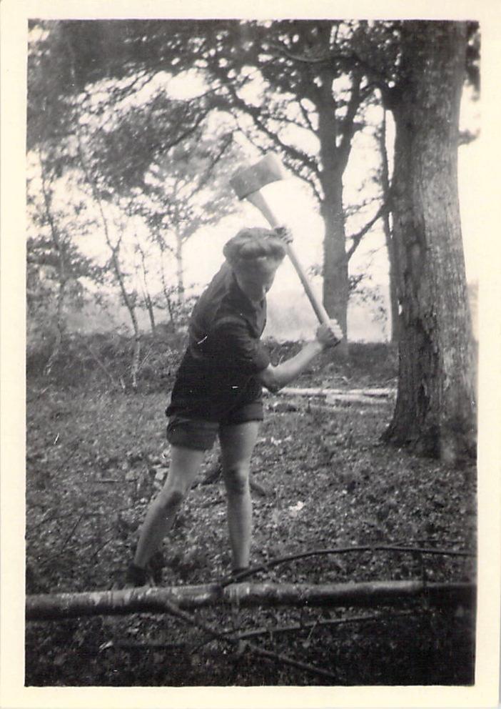 A Lumber Jill felling a tree.