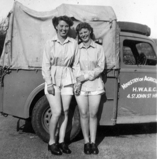 Land Girls in Weobley in front of a Ministry of Agriculture lorry