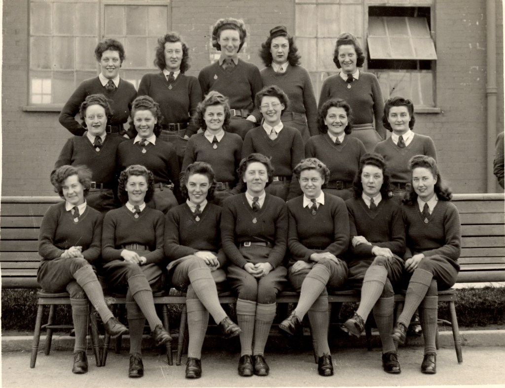 Land Girls sitting outside a hostel