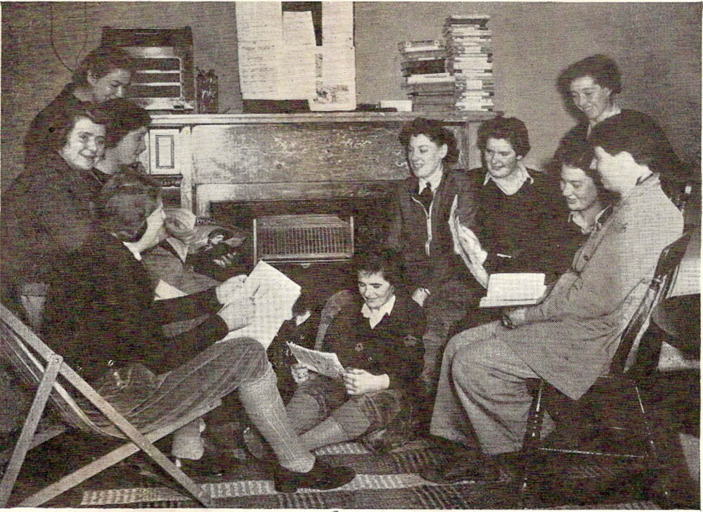 Land Girls reading at Pawston Hostel, Northumberland.