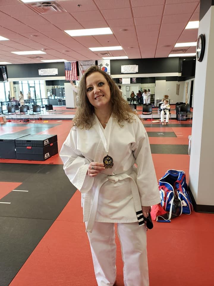 woman in taekwondo uniform