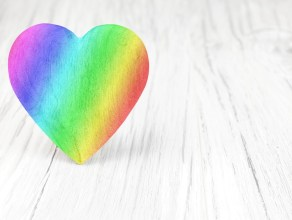 rainbow coloured heart on a white background