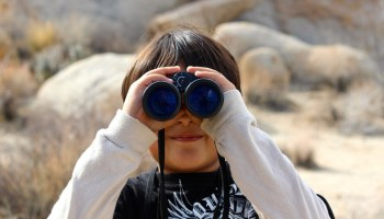child-on-a-trek-with-binoculars