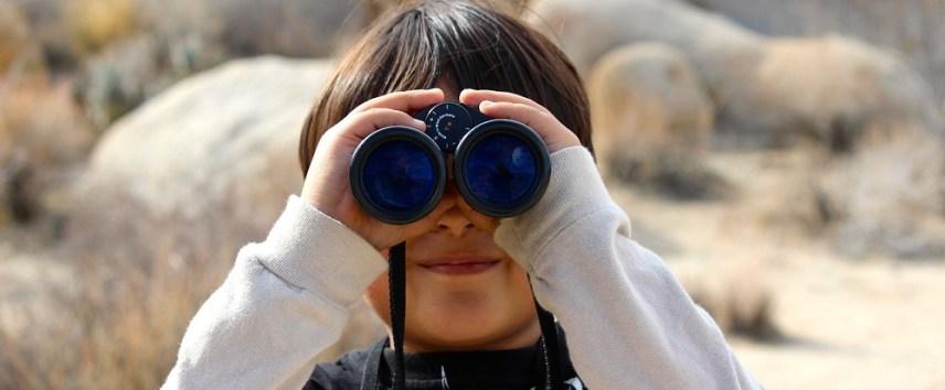child-on-a-trek-with-binoculars