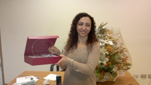 Sandy at her farewell party at Lead Foundation, with a souvenir from Karim Fanous, Lead's executive director.
