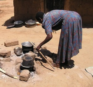 2014-05-05 Woman Cooking in Uganda by Mark Jordahl