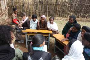 Ryan Newton and Anjali Banthia (Product Development) conduct a focus group in Lumame, Ethiopia for a youth savings program