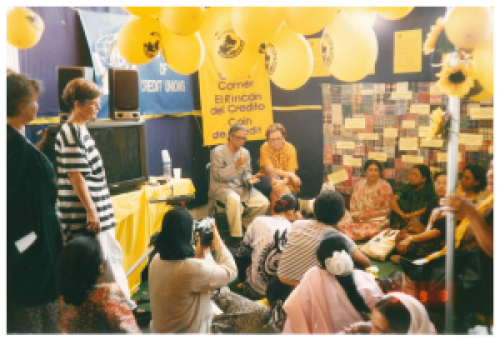 Muhammad Yunus (Grameen Foundation) and Nancy Barry (then Women's World Banking President Nancy Barry) at the Credit Corner  at the Fourth World Conference on Women (Beijing, 1995)