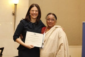 Viji Das with Women's World Banking CEO, Mary Ellen Iskenderian, receiving an updated Certificate of Membership to the Women's World Banking network