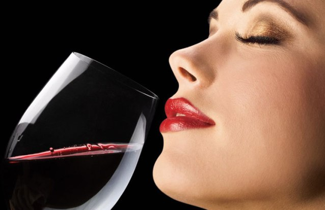 Girl using red wine on face for glowing skin