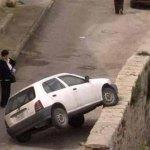 car 1 wheel on boundary wall