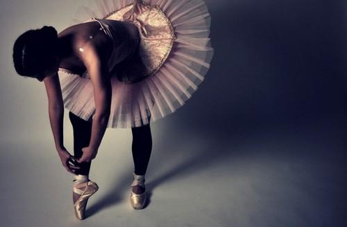 Ballerinas Preparing Their Pointe Shoes