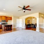 21728928 – new home kitchen interior and large empty living room
