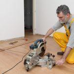 40657933 – worker cut wooden batten for laminate floor,  floating wood tile