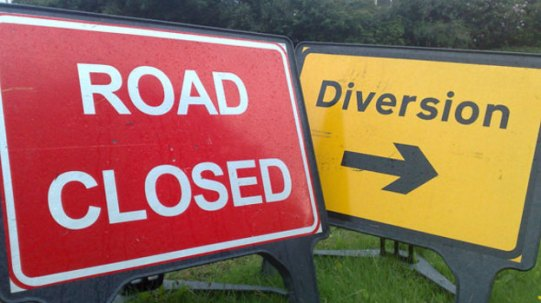 road closed and diversion sign