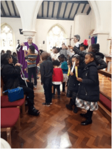 Children gathered around the alter at church