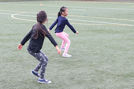 Students run laterally in PE