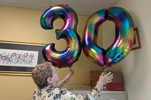 Bogda displays her 30th anniversary balloons
