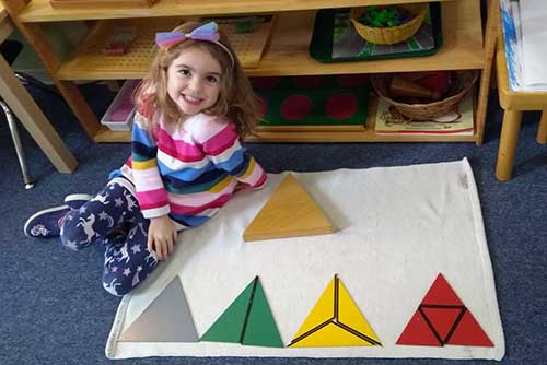 A student displays her triangle work