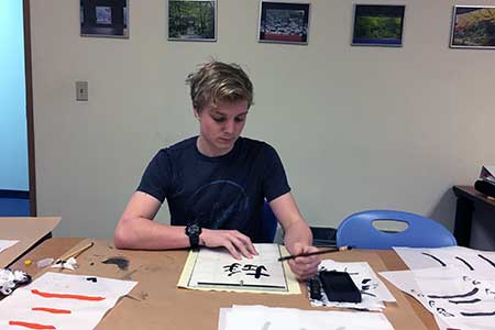 A student practices calligraphy