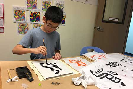 A student works on his kanji