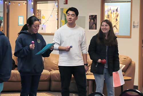 High school students sing a holiday son in Spanish