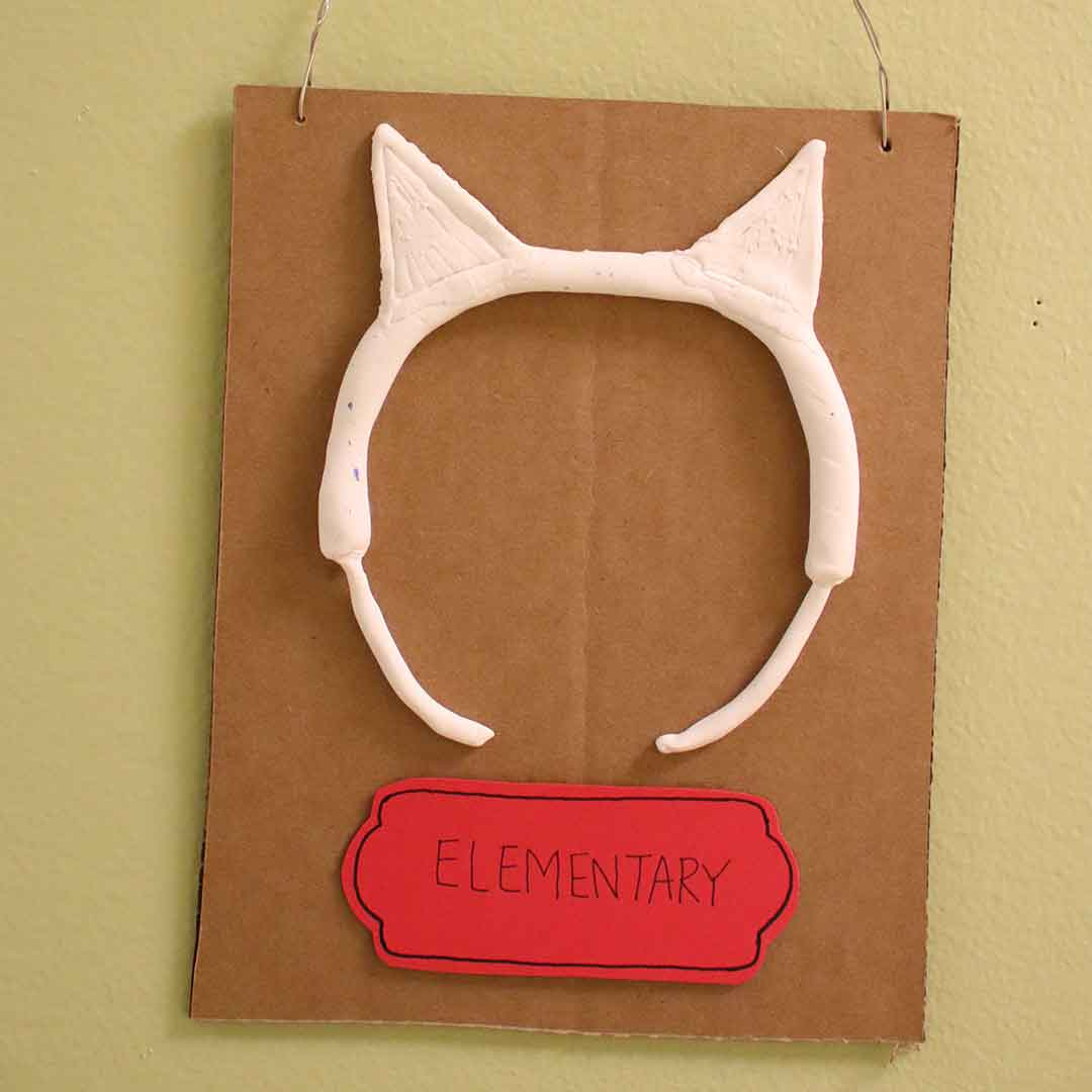 A plaster rendering of a head band with kitten's ears