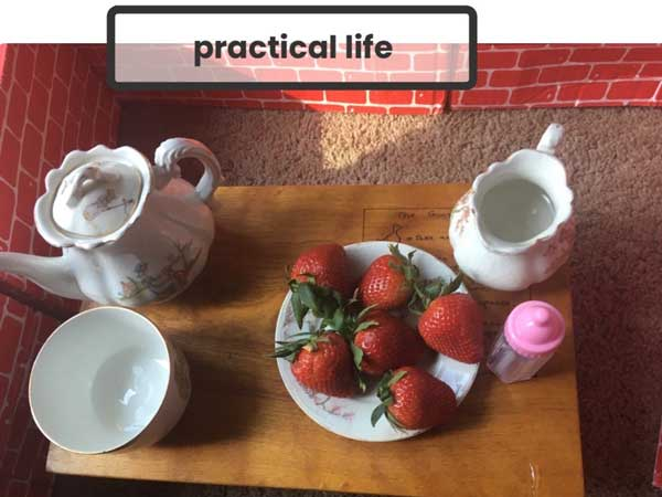 A table setting withe strawberries on a plate