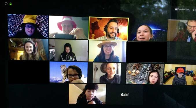 A grid shows the faces and a name of students, teachers and a guest speaker during a video conference