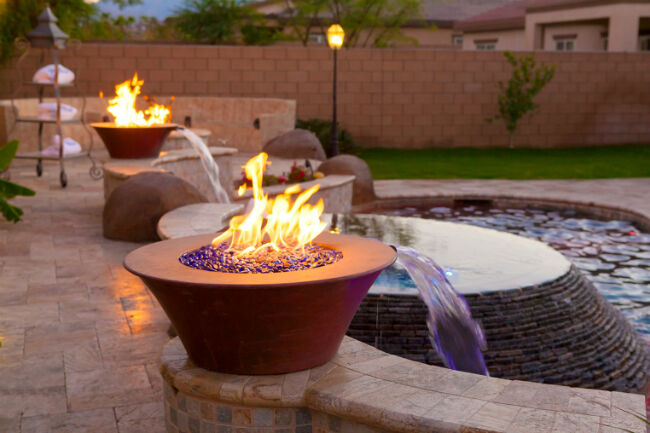 a fire pit under a covered patio