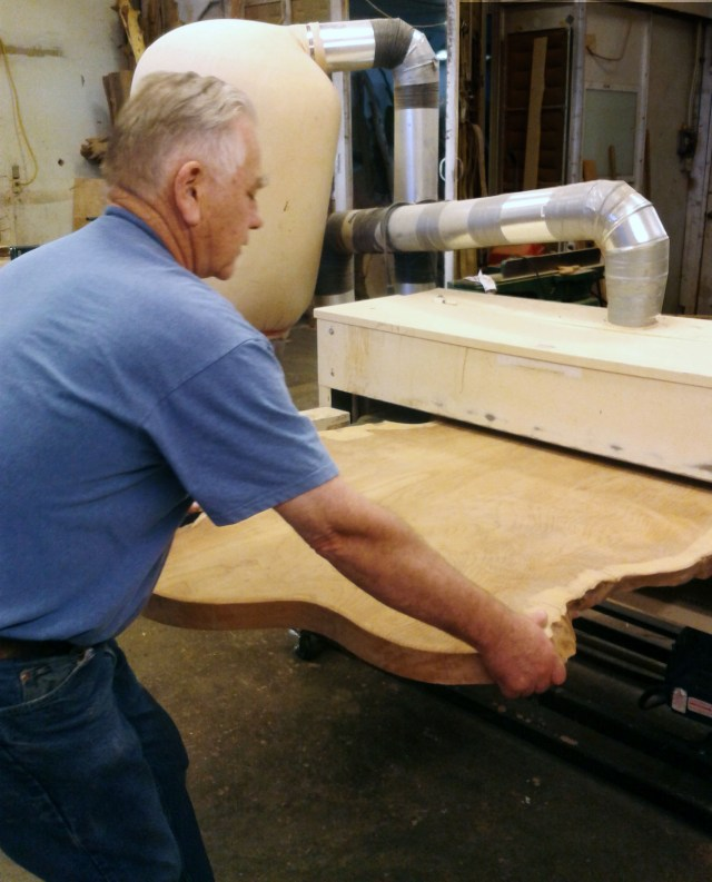 Logger-turned-woodworker, Mark Abernathy, turns a single slab of wood into a handsome, rustic tabletop with his 50″ Woodmaster Drum Sander.