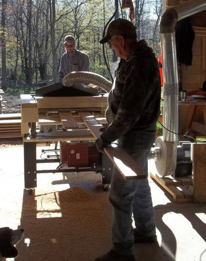 Bob's dad and one of his brothers lend a hand running the wood to make turkey calls through the Woodmaster.